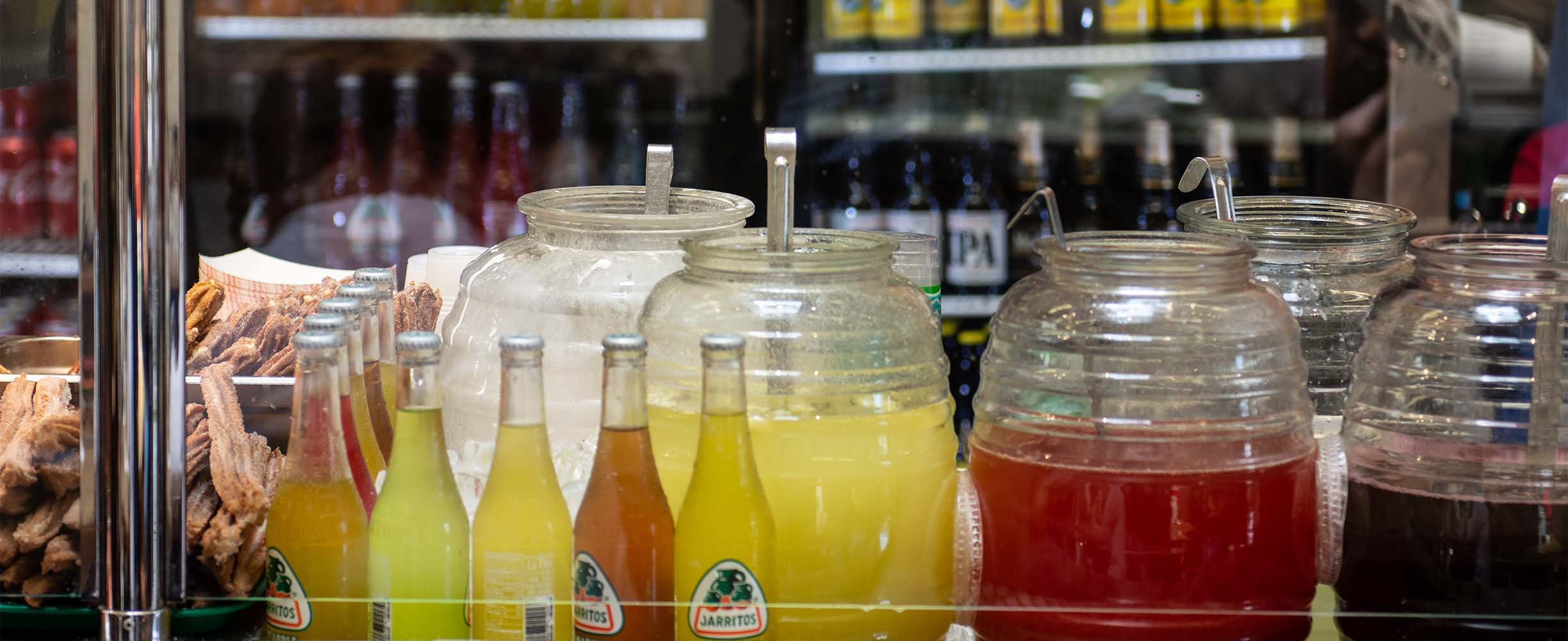 Traditional Mexican Aguas, or fresh friuit juices.